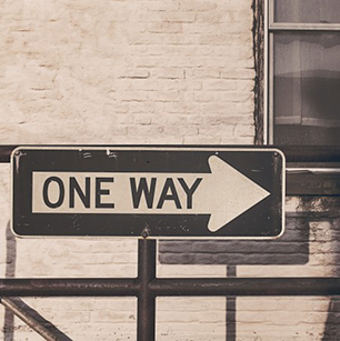 one-way-road-sign-sepia-tone-photo